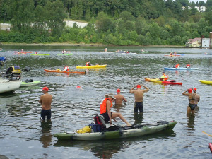Another wave of swimmers and escorts enter the water