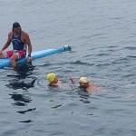The high-five hand-off: in the water for his third leg