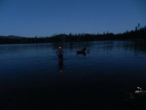 Walking out to begin a night swim at Elk Lake