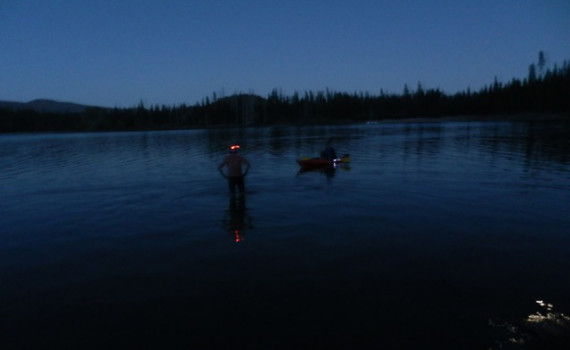 Walking out to begin a night swim at Elk Lake