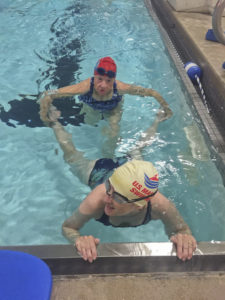 Virginia, working with other swimmers during a workout