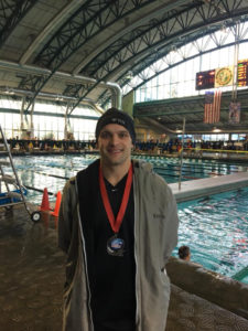 Kevin Cleary with his 2nd place medal from the 200 breast