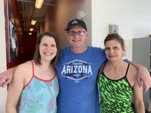 Mother and daughter one-hour ePostal swimmers, Heather Blair and Laraine Elsten, with Dennis Baker
