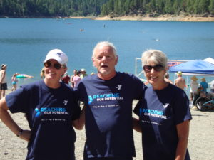 Michael Grant (middle) - coach of GPY - with Denise Silberman and Cathy Milner from Grants Pass YMCA (GPY) swimmers