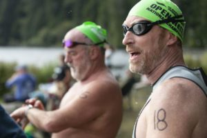 Open Water Swimmer Shawn Orchard, right, of Tigard catches his breath Saturday after the 3,000-meter swim during the 15th-annual US Masters Open Water Swim Meet at Eel Lake