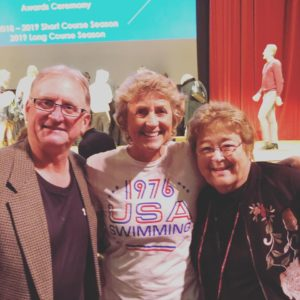 Dennis Baker and Kim Payton's mother Barb with Karen Andrus-Hughes at the Oregon Hall of Fame Swimming induction of Kim 2019. 11.17