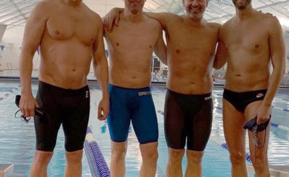 Men's 400 medley relay -Matt Osborn, Mike Servant, Christian Tujo and Brad Cota