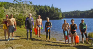 Eel Lake swimmers— left to right: two unknown swimmers, Helen Slack Miller, Arianna Elnes, Laura Schob, Dave Radcliff, Mike Carew, Ed Ramsey