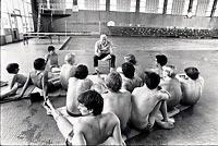 Dick Hannula, now 91, talking with his team before a meet in 1983, won 23 consecutive state swimming championships, making him the most successful coach in Washington high-school history. (SEATTLE TIMES, 1983)
