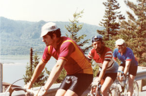 """Three of the four participants on the """"Tri-America"""" Team to run/swim/bike across America. They crossed the northern tier of the USA in 1983. Chris Oakes, Mike Russel with Tim Smith at the end."""
