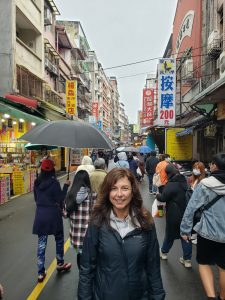 Marcie Adelman standing on a busy street in Taipei
