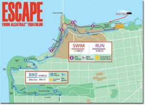 This is a map of the current course of the commercial version of the ESCAPE FROM ALCATRAZ TRIATHLON. The 1.5-mile swim is in red. The 18-mile bike route is in blue, and the out-and-back run is in purple. This is quite different from the original 1981 course: No Golden Gate Bridge; no Dipsea Trail. (For comparison, the distances in the IRONMAN TRIATHLON are 2.4 miles swim in relatively calm, warm water; 112 miles on a bicycle and a 26.2-mile marathon run.)