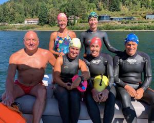 Mark Crosby, Jayette Pettit, Beth Martell, Doug Brockbank, Suzy Jajewski, and Arlene Del- mage enjoy a beautiful day on the Columbia River